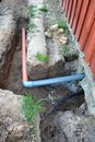 Trench near house with water and sewerage pipes Royalty Free Stock Photo