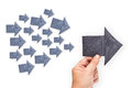 Trend leader hand hold a paper arrow as with many small arrows as followers Royalty Free Stock Photo