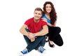 Trendy adorable love couple sitting on floor Royalty Free Stock Photo