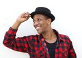 Trendy african man smiling with hat Royalty Free Stock Photo