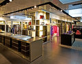 Trendy boutique of clothing and shoes with nice interior and furniture Royalty Free Stock Photography