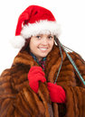 Trendy christmas girl with plait braids in fur coa Stock Images