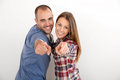 Trendy couple isolated pointing fingers towards camera Royalty Free Stock Photo