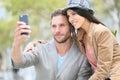 Trendy couple making selfie Royalty Free Stock Photo