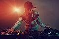 Trendy dj hiphop woman playing at nightclub party lifestyle Royalty Free Stock Photos