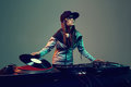 Trendy dj hiphop woman playing at nightclub party lifestyle Stock Images