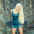 Trendy girl with skateboard. Royalty Free Stock Photo
