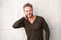 Trendy guy with beard smiling Royalty Free Stock Photo