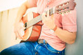Trendy guy with guitar outdoor Royalty Free Stock Photo