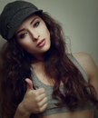 Trendy hiphop style girl showing thumb up closeup vintage portrait Stock Photos