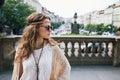 Trendy hippie woman tourist standing on Wenceslas Square, Prague Royalty Free Stock Photo