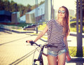 Trendy Hipster Girl with Bike in the City Royalty Free Stock Photo