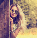 Trendy hipster girl on summer nature background in sunglasses modern youth lifestyle toned photo Stock Photos