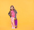 Trendy little girl child listening to music in headphones Royalty Free Stock Photo