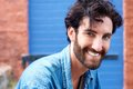 Trendy modern man with beard smiling Royalty Free Stock Photo