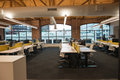 Trendy modern open concept loft office space with big windows, natural light and a layout to encourage collaboration Royalty Free Stock Photo