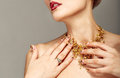 Trendy nail design and beautiful necklace of golden pins safe Stock Image
