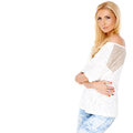 Trendy slim blond woman beautiful in designer jeans standing looking at the camera three quarter portrait isolated on white Royalty Free Stock Photos