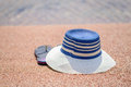 Trendy sunhat and beach thongs on the sand Royalty Free Stock Photo