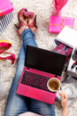 Trendy woman with coffee and laptop Royalty Free Stock Photo