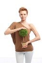 Trendy woman holding potted plant young with short hair green smiling Royalty Free Stock Photos