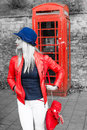 Trendy young blond woman standing waiting Royalty Free Stock Photo