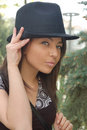 Trendy young woman in hat Stock Photography