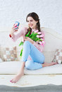 Trendy young woman posing one her phone camera Royalty Free Stock Photo
