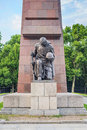 Treptower park kneeling statue in soviet war memorial berlin germany Royalty Free Stock Image