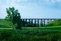 Tressel bridge old outside of minot nd with a train going across the with tanker cars Royalty Free Stock Images