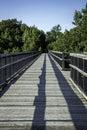 Trestle bike path bridge over river Royalty Free Stock Photography