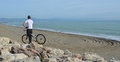 Trials bike rider torremolinos andalucia spain december young with on rocks beach spain Royalty Free Stock Photography