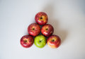 Triangle of apples group six in shape on top white clean table Royalty Free Stock Image