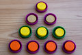 Triangle of colorful plastic lids