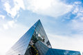 Triangle glass modern building and blue sky Stock Image