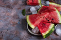 Triangle shaped watermelon slices placed