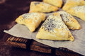 Triangular cookies with poppy seeds
