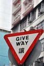 Triangular give way traffic warning board and a bird bird,hongkong Royalty Free Stock Photo