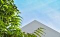 Triangular roof and blue sky
