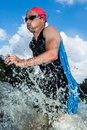 Triathlete running out ot the water Royalty Free Stock Photo