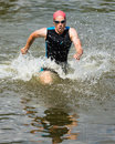 Triathlete is running out ot the water Royalty Free Stock Photography