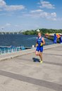 Triathlon athlete running on the street dnepropetrovsk july egor martynenko winner of men s race at city streets during ukrainian Stock Photo