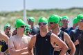 Triathlon competitors waiting at start line Royalty Free Stock Photo