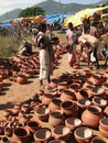 Tribal women buy clay pots Stock Photo