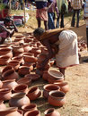 Tribal women buy clay pots Stock Photography