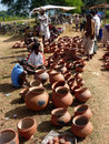 Tribal women buy clay pots Stock Image