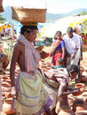 Tribal women buy clay pots Royalty Free Stock Photo