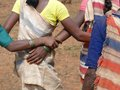 Tribal women link arms Royalty Free Stock Images