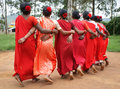 Tribal women performing dimsa dance india group of from araku valley in red cloths and red flowers in hair Royalty Free Stock Images