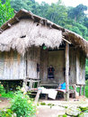 Tribe s home a tribesman is made from wood banboos and staw Stock Image